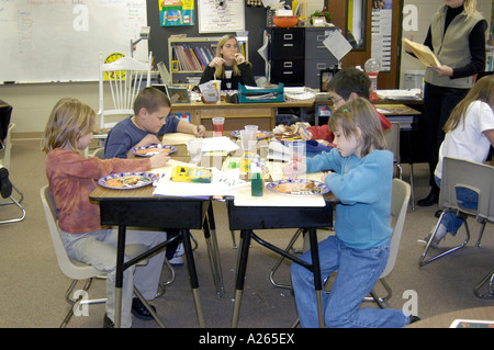 3rd grade elementary students working in group - Stock Photo