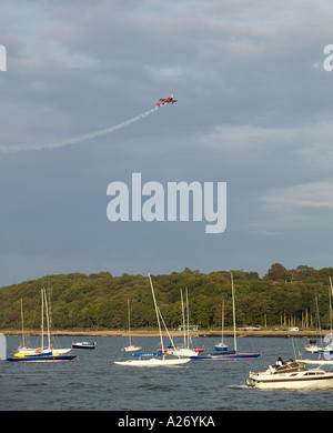 Stunt plane over Cowes Isle of Wight - Stock Photo