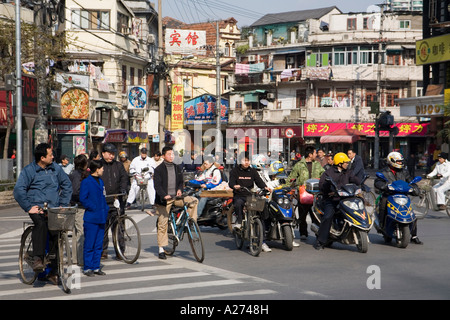 Bikers waiting for green light in the old town of Shanghai, China - Stock Photo