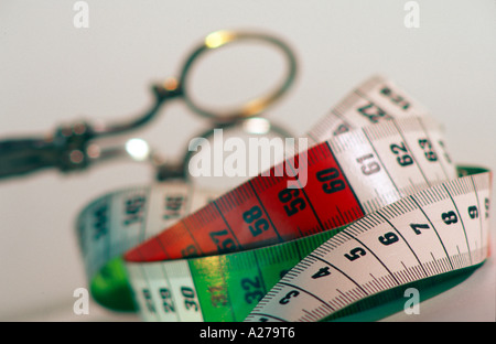 still life stillife of tapeline tape measure and scissors - Stock Photo