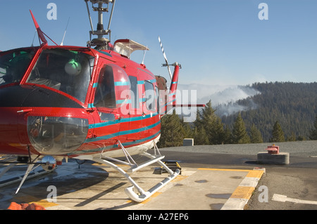 Hughes helicopter used by forest fire fighters. - Stock Photo