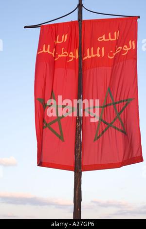 arabic flag near djemaa al fna and koutoubia mosque in marakesh morocco - Stock Photo