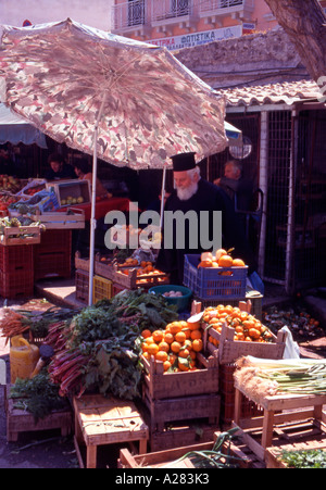 Greece Ionian Islands Corfu A Greek Orthodox Priest shopping in The Old Town Market - Stock Photo