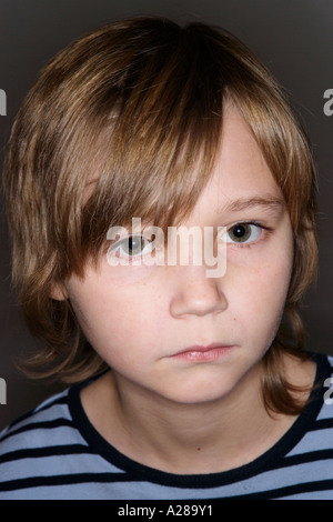 CLOSE UP PORTRAIT OF 11 YEAR OLD BOY - Stock Photo