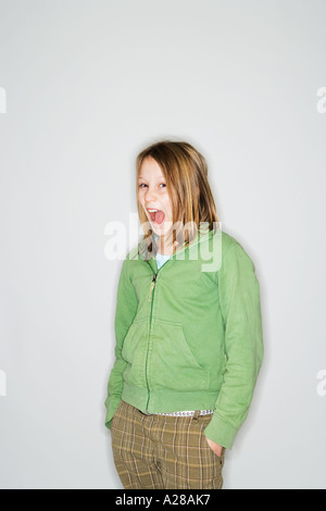 PORTRAIT OF 11 YEAR OLD GIRL WITH HANDS IN POCKETS - Stock Photo