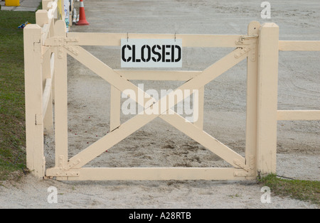 closed sign on fence - Stock Photo