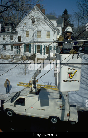 Line Technician Larry Price checks cable TV connections from bucket for Cable TV Montgomery in Rockville Maryland - Stock Photo