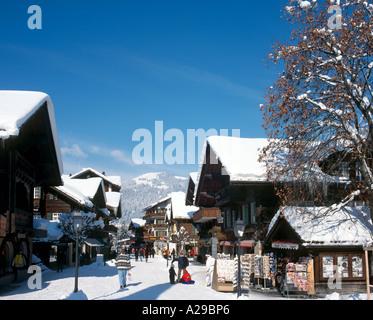Shops in the resort centre of Gstaad, Swiss Alps, Switzerland - Stock Photo