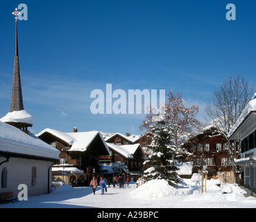 Shops and church in the resort centre of Gstaad, Swiss Alps, Switzerland - Stock Photo