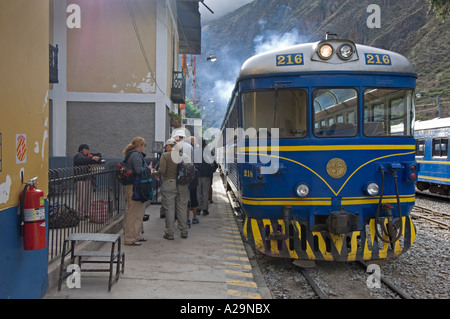 A group of tourists boarding the Ferrostal train to Aguas Calientes from where you take a coach up to Machu Picchu. - Stock Photo