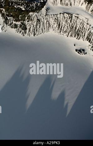 South Georgia Island, Antarctica, Aerial of Quensel Glacier with shadows of Ferguson Peak - Stock Photo