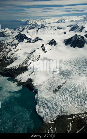 SOUTH GEORGIA ISLAND, Antarctica,  Aerial of Helland Glacier below Mt Paget Highest peak on S. Georgia 9625 feet - Stock Photo