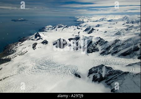 SOUTH GEORGIA ISLAND, Antarctica,  Aerial of Helland Glacier below Mt Paget Highest peak on South Georgia 9625 feet - Stock Photo