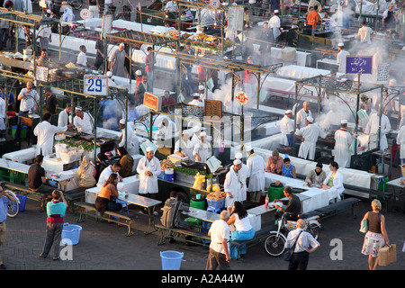 Food stalls in Jemaa el Fna Square .at sunset Marrakech. Morocco - Stock Photo