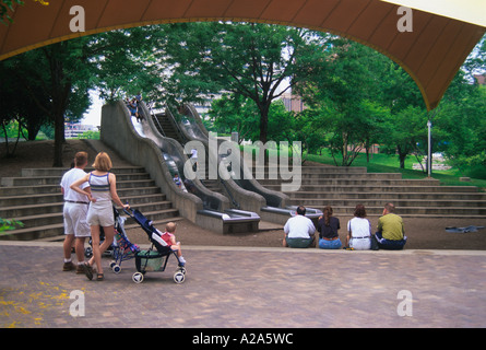 Children playing at a playground in the Gene Leahy Mall in downtown Omaha, Nebraska. - Stock Photo