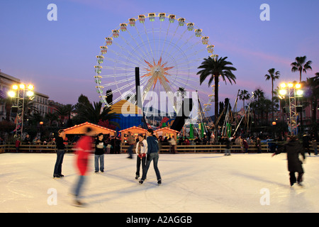 Skating rink and ferris wheel at the annual christmas market in Nice France - Stock Photo