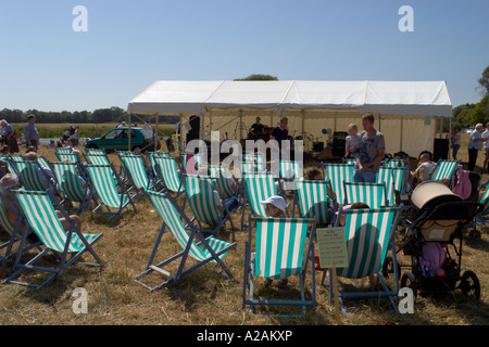 St Ives summer regatta deck chairs in the field - Stock Photo