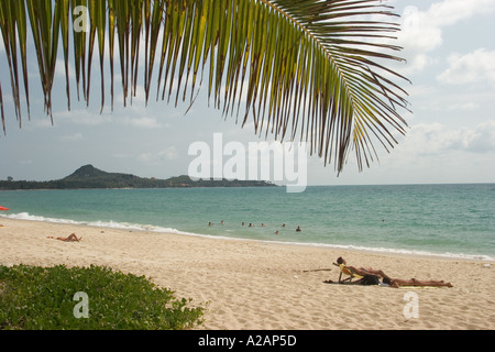 Thailand Ko Samui East Coast subathers on Lamai beach - Stock Photo