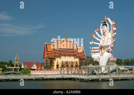Thailand Ko Samui Religion Buddhism Wat Nuan Naram with giant statue of multi armed Buddhist Deity - Stock Photo