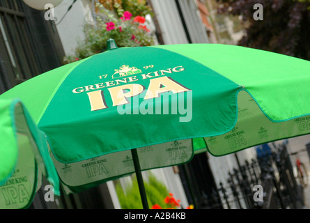 Greene King IPA logo on a parasol in a pub beer garden in London, England, UK - Stock Photo