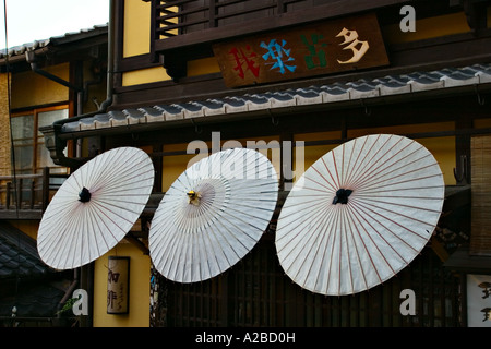 Umbrellas in front of a cafe in Kyoto, Japan, Asia - Stock Photo