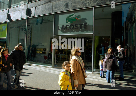 44f093ce033d ... Shoppers pass the Lacoste store on Fifth Avenue in Midtown Manhattan -  Stock Photo