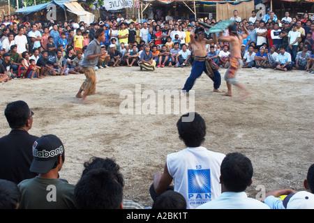 Traditional Stick Fighting Match, Mataram - Stock Photo