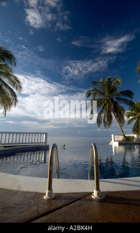 infinity pool to caribbean sea corn island nicaragua resort central america - Stock Photo