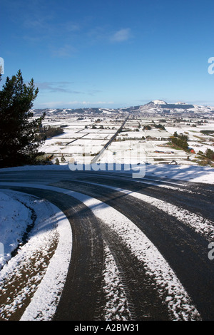 Road Taieri Plain and Saddle Hill in snow near Dunedin South Island New Zealand - Stock Photo