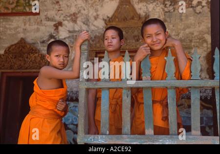 Novice Buddhist monks at the village wat of Ban Pak Ou, near Luang Prabang, Laos - Stock Photo