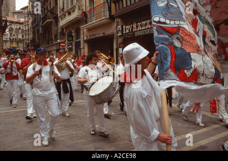 Traditional Spanish marching band marching through the streets during the Fiesta de san Fermin, Pamplona, Navarra, - Stock Photo