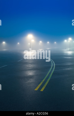 Foggy Parking Lot At Night - Stock Photo