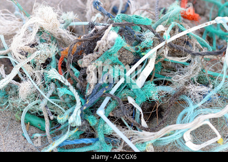 Samples of discarded fishing line and nets found on a beach - Stock Photo