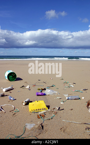 Rubbish washed up on a beach - Stock Photo