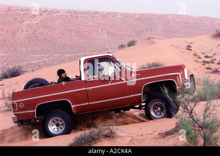 Oman. Wahiba Sands. Tourists visting the Wahiba Sands in the interior. Dune bashing is a popular sport - Stock Photo