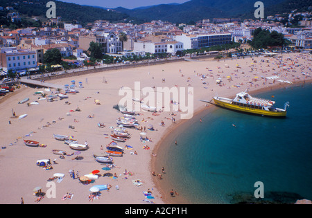 passenger ship at the beach of Tossa de Mar at the Costa Brava in Spain - Stock Photo