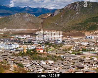 aerial view of old Tibetan town and monastery giant prayer wheel Shangri La China - Stock Photo