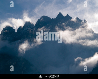 peaks of the Jade Dragon Snow Mountains in the clouds Tiger Leaping Gorge China - Stock Photo