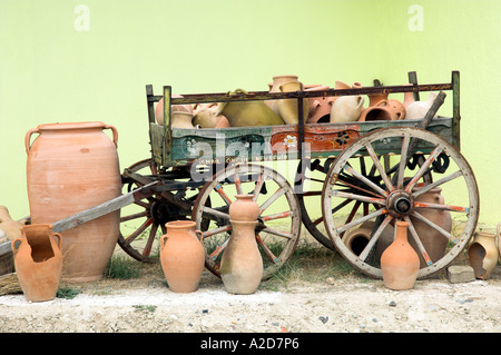 A display of clay pots on a old wooden wagon for sale in Cappadocia, Turkey. - Stock Photo