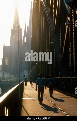 Crossing railway bridge, Hohenzollern,  across the Rhine River with hazy Colgone Cathedral in the  background, - Stock Photo
