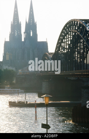 Hohenzollern Railway bridge across the Rhine River with hazy Colgone Cathedral in the background, - Stock Photo