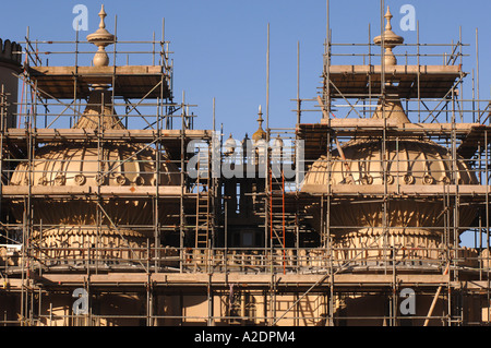 The domes of the Prince Regents Palace The Royal Pavilion Brighton East Sussex are covered in scaffolding for stonework - Stock Photo