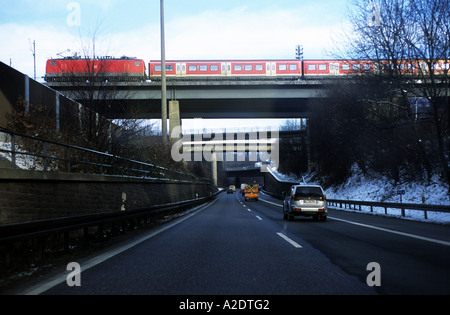 Regional passenger train (RB Regional Bahn) passing over a motorway bridge, Wuppertal, North Rhine-Westphalia, Germany. - Stock Photo