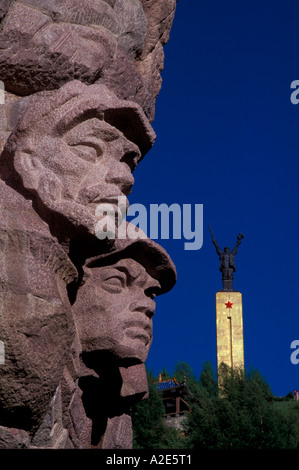 Monument to People's Liberation Army, with moon rising behind. - Stock Photo