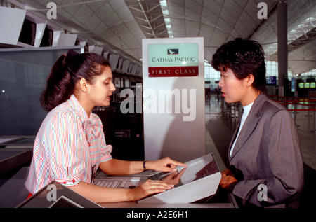 First-class check-in for Cathay Pacific Airlines, Hong Kong's flag carrier,at Chek Lap Kok International Airport. - Stock Photo