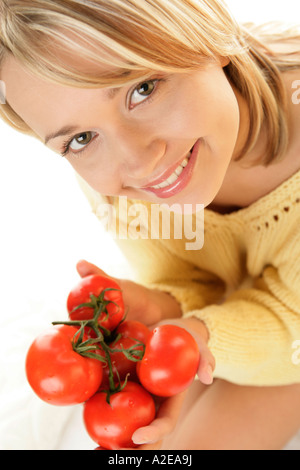 Young woman with tomatoes - Stock Photo