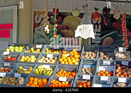 A fruit stall and dried Codfish Bacalhau Lagos Algarve Portugal - Stock Photo