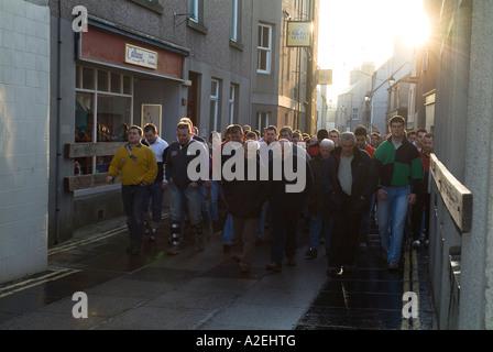 dh The Ba KIRKWALL ORKNEY Doonies Ba team walking up Victoria street to start The Ba - Stock Photo