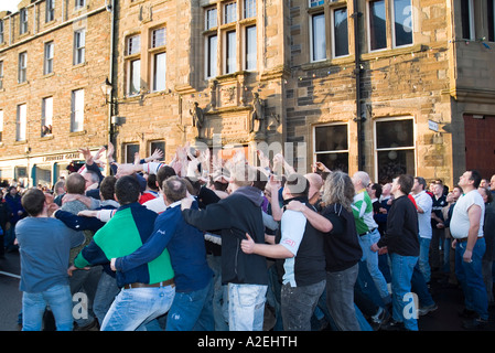 dh The Ba KIRKWALL ORKNEY Start of the Ba throw up in front of town hall christmas day - Stock Photo