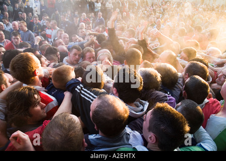 dh The Ba KIRKWALL ORKNEY Steaming pack of Ba players and spectators in Broad Street game uk football - Stock Photo